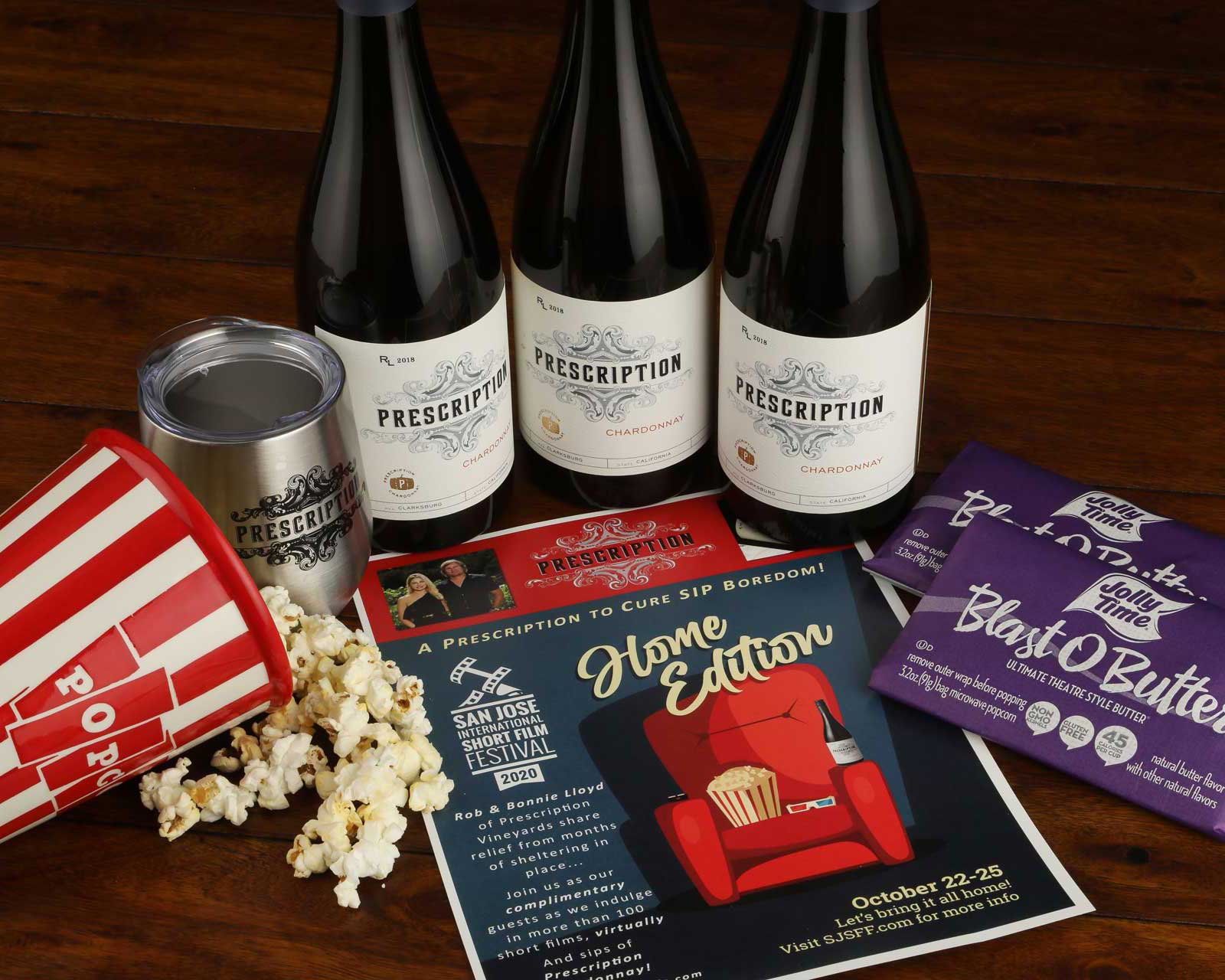 image of popcorn and wine bottles with movie flyer